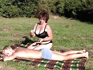 Dark Haired Bbw-cougar Outdoors By Youthfull Boy