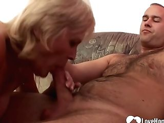 Matures Blonde Woman In Black Stockings And Garter Belt Is Having Casual Orgy On The Sofa